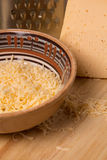 Grated cheese for cooking dishes Stock Images
