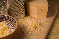 Grated cheese for cooking dishes Royalty Free Stock Image