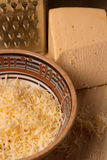 Grated cheese for cooking dishes Stock Photo
