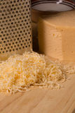 Grated cheese for cooking dishes Stock Image