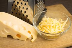 Grated Cheese on cutting board Royalty Free Stock Images