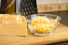 Grated Cheese on cutting board Royalty Free Stock Photography