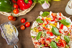 Grated cheese for fresh pizza home Stock Image