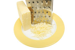 Grated cheese and grater Stock Photography