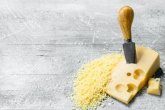 Grated cheese with knife royalty free stock images
