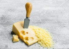 Grated cheese with knife stock photography