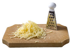 Grated cheese mix on wooden cutting board with one little grater Royalty Free Stock Images