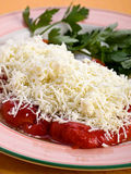 Grated cheese with pepper Stock Images