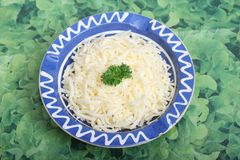 Grated cheese. Some grated gaude cheese in a bowl royalty free stock photos