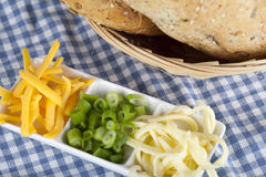 Grated cheese with spring onion and seed bread. Two cheeses and spring onion with seed bread Royalty Free Stock Photos