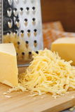 Grated cheese on the table Stock Images