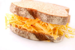 Grated Cheese and Wholemeal Bread Sandwich. A delicious sandwich consisting of wholemeal bread and grated cheddar cheese Stock Images