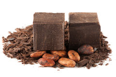 Grated chocolate, chocolate chunks and cocoa beans Stock Image