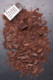 Grated chocolate and cocoa beans Stock Image