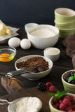 Grated chocolate with different ingredients for cooking chocolat Stock Photos