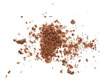 Grated chocolate isolated on white background. Top view Stock Images