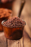 Grated chocolate, powder and cocoa beans Stock Photos