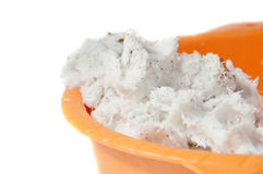 Grated coconut in the orange bowl Stock Image