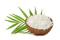 Grated coconut in shell on background. Grated coconut in shell on white background royalty free stock photography