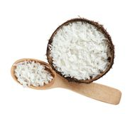 Grated coconut in shell and wooden spoon on background. Grated coconut in shell and wooden spoon on white background stock photos