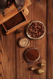 Grated coffee in old iron weights and wooden  background Royalty Free Stock Image