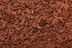Grated dark chocolate. Background of grated dark chocolate Stock Photo
