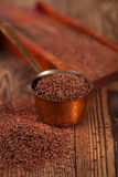 Grated dark chocolate in copper measure pan Stock Image