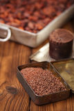 Grated dark chocolate in tin with cocoa beans and solid piece in Royalty Free Stock Photos