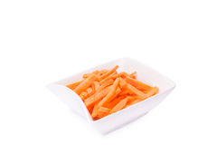 Grated fresh carrot in white bowl isolated Stock Photo