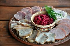 Grated horseradish with beetroot and meat stock images