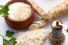 Grated horseradish with pepper mill Royalty Free Stock Images