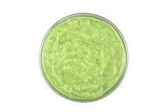 Grated horseradish sauce with green in glass containers Stock Images