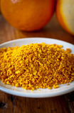 Grated orange rind. A plate of dry grated orange rind Royalty Free Stock Images