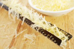 Grated Parmesan Cheese and Microplane Rasp Grater Royalty Free Stock Images