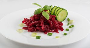 Grated Pickled Beet Root or Beetroot Salad on White Plate. Exquisite Serving Restaurant Plate of Grated Pickled Beet Root Salad on White Plate. Macro Photo of royalty free stock image
