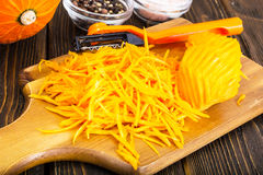 Grated pumpkin for cooking Stock Photography