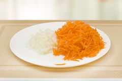 Grated raw carrots and chopped onions Royalty Free Stock Images