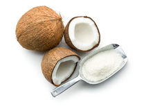 Grated, whole and halved coconut Royalty Free Stock Image
