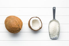 Grated, whole and halved coconut Royalty Free Stock Photography