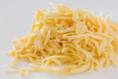 Grated yellow cheese Stock Images