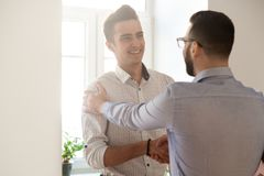 Grateful boss handshaking employee congratulating with job promo. Tion, appreciating good results, friendly ceo proud of subordinate shaking hand expressing royalty free stock photos