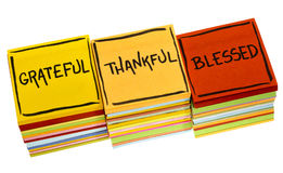 Grateful, thankful, blessed spiritual words. Handwriting in black ink on an isolated sticky note royalty free stock photos