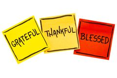 Grateful, thankful, blessed  spiritual words. Handwriting in black ink on isolated sticky notes Royalty Free Stock Image