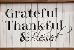 Grateful thankful and blessed. Words grateful thankful and blessed print on wood royalty free stock photo