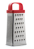 Grater. Metal grater with plastic red handle isolated on white stock images