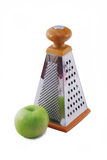 Grater and apple Royalty Free Stock Photography