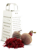 Grater and beets Royalty Free Stock Photography
