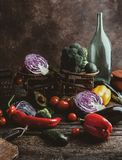grater, bottle, cutting board, scales and pile of different vegetables on rustic royalty free stock image