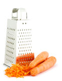Grater and carrots royalty free stock image