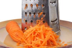 grater and carrots Stock Image